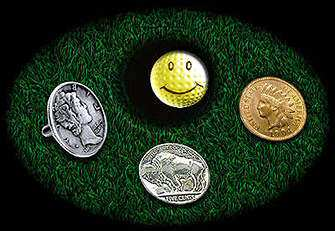 golf balls , golf ball markers , golf